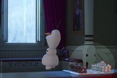 When the wind opens the window, the White Queen (which symbolizes the Queen Elsa) falls from the chess board. Clever detail, Disney.