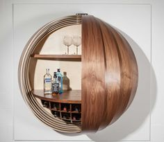 With curved, segmented panels of wood veneer, the Dime cabinet references the look of a spinning coin.