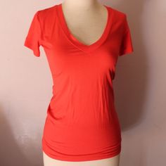 Angie NWT pink coral v neck tee super soft size S Angie NWT pink coral v neck tee super soft size S 95% viscose 5% spandex RN#060508 made in China Angie Tops