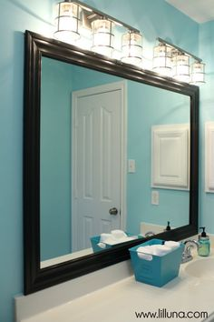 Bathroom Mirror Makeover upgrade your standard builders mirror with this diy framing