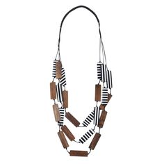Named for the purser, the keeper of the money on-board a ship, the Marimekko Purseri Necklace tallies up 24 rectangular beads for a precious collection of style. Six beads are all wood, and the rest ar