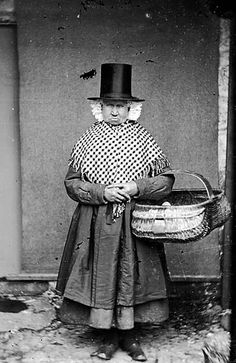 An elderly women, wearing traditional Welsh constume and carrying a basket. People's Collection Wales  Date: 1875