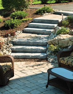 These landscape steps provide a smooth transition from the driveway to the patio of this sloping yard. Find solutions to your landscape problems at cstpavers.com