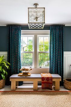 If your drapes have enough length, consider moving the curtain rod closer to the ceiling to give the room a greater sense of height. #decorideas #upcycledecor #homedecor #bhg