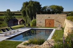 Pool built into the old foundation of a barn.  farmhouse pool by Northworks Architects and Planners