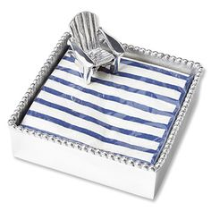 This charming Adirondack cocktail napkin holder with napkins is made of a heavy-duty recycled aluminum in a silver look that will not tarnish. With its beaded trim and miniature Adirondack-chair paperweight, it's perfect for outside entertaining or giving as a unique hostess gift.