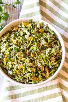 Crispy green rice, made green from lots of finely chopped herbs, currants, and thinly sliced sugar snap peas. Perfect for spring and summer picnics.
