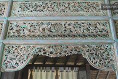 Detail of carving above bedroom door.