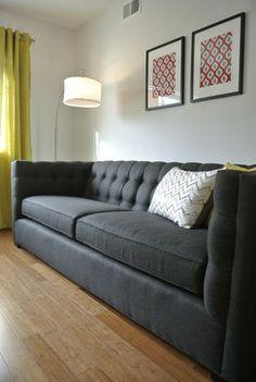 Mason St. Apartments - modern - living room - omaha - The Modern Hive #popofcolor #accentpillows #green #wallart #greysofa #tuftedsofa #chevron #midcenturymodern #bamboofloor
