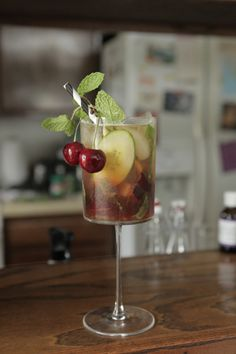 Cherry Bomb: gin, Pimm's #1, lemon juice, simple syrup, cherries, cucumber, mint, celery bitters | Loving Cup //