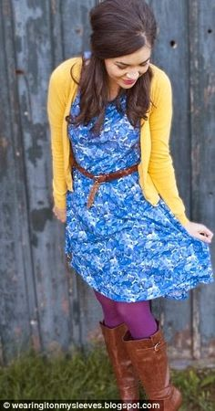 Yellow sweater and blue flowery gown with purple leggings and long boots