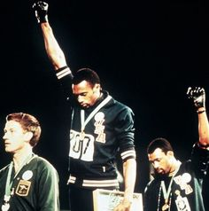 Tommie Smith (centre) and John Carlos give the black power salute supported by Australian Peter Norman