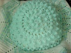 Ravelry: Project Gallery for Puff Stitch Round Pillows pattern by Terry Day