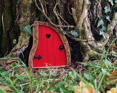 Fairy Door 'Iris' in Red Red Fairy door Fairy door | Etsy Fairy Doors On Trees, Fairy Garden Doors, Tooth Fairy Doors, Yellow Doors, Climbing Vines, Rustic Doors, Arched Windows, Photo Tree, Fairy Houses