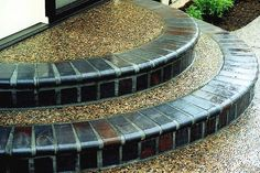exposed aggregate patio | Charcoal brick masonry borders exposed aggregate steps