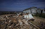 A year ago this week, Hurricane Sandy slammed into the Mid-Atlantic. While much of the evidence has been razed and removed from the gleamingly rebuilt towns all along the eastern Jersey Shore, along the western shore it's like Sandy never left.