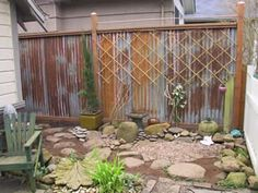 Fence Made From Doors | Fence made from rusted corrugated tin salvaged from old barns.