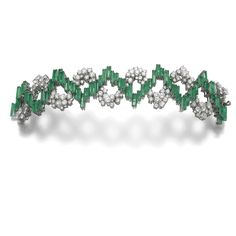 Emerald and diamond bracelet Composed of undulating bands of step-cut emeralds and circular-cut diamonds, length approximately 170mm.