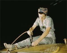 Unidentified woman drilling on a Liberator Bomber.
