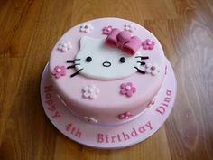 A very special pink fondant cake for a little girl with pink fondant bow and Hello Kitty fondant cut-out. Bolo Kitty, Bolo Da Hello Kitty, Hello Kitty Fondant, Hello Kitty Cupcakes, Hello Kitty Cake Design, Hello Kitty Theme Party, Hello Kitty Birthday Cake, Kitty Party, Cake Birthday