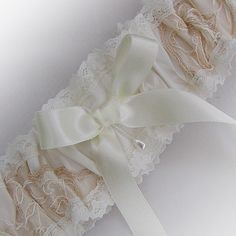 We had such lovely comments about this garter when we made it in dusky blue that we have now made a version in blush pink and ivory with champagne