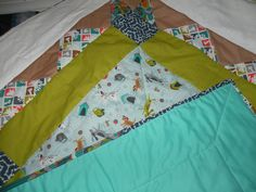Fat Quarter quilt with hand made bias tape binding from leftover fabric.  45x45 square size.