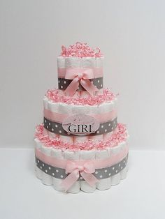 *Nice change from the typical baby shower cake. Pretty centerpiece can be made but pink and cream. Baby Girl Pink And Gray Diaper Cake Baby Shower Centerpiece Cadeau Baby Shower, Idee Baby Shower, Shower Bebe, Baby Shower Diapers, Girl Shower, Baby Shower Cakes, Baby Shower Themes, Baby Shower Gifts, Shower Ideas