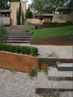 Metal retaining walls with a natural oxidized patina and filled with gravel