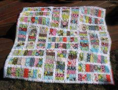 jelly roll quilt with white sashing