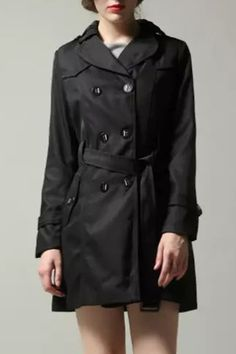 The coat featuring double breasted design. Button tab to cuff.