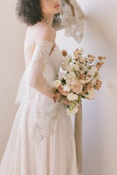 "From the editorial ""Earth Tones, Textures and Minimalism Created Magic at One of LA's Newest Wedding Spaces."" The Marie couture wedding dress from Claire Pettibone is a beautiful vintage-inspired piece with a two tone lace and French embroidered bodice. Head to SMP for more of this gorgeous wedding shoot!  Photography: @thismodernromance Gown: @clairepettibone  #weddingdress #brideinspo #weddinggown #bridedress #clairepettibone"