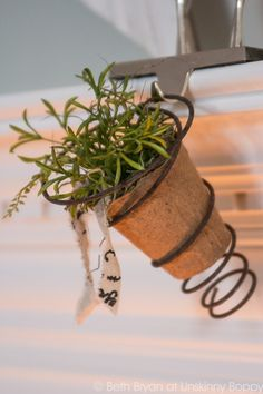 Cute Bedspring planter on a Christmas mantel- @ unskinnyboppy