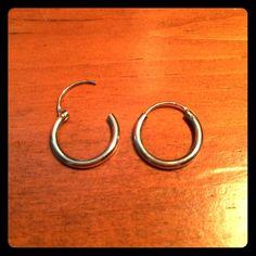 Sterling silver small hoop earrings Marked 925 on earring post sterling silver hoops. Very cute! Jewelry Earrings