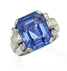 A sapphire and diamond ring, circa 1935 The step-cut sapphire, weighing 18.48 carats, between arched baguette and single-cut diamond shoulders, sapphire approximately 18.60 carats