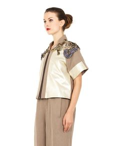 ANTONIO MARRAS SHORT ZIPPERED JACKET S/S 2016 Beige short jacket mandarin collar short sleeves leather inserts two concealed side pockets decorated with stones and metal details front zipper closure 53% LY 46% LI 1% WX  100% Leather