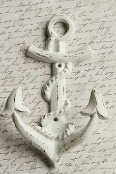 The wall anchor decoration has a slightly hammered effect, which ties into the shabby chic style perfectly. It's another simplistic decoration that is very effective in this kind of room.