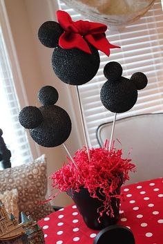 Styrofoam balls, glue & black glitter and you have perfect Mickey or Minnie party decor!