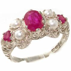 """</html> <font face=""""Eras Light ITC"""" color=""""#000000"""" size=""""3"""">A Beautiful Ruby & Pearl ring of good quality set with a centre oval 7x5mm & two 3.25mm round Rubies & four 3.25mm round Cultured Freshwater Pearls in a Sterling Silver setting.  <p>Measurements : 9mm (L) x 18mm (W) x 4mm (H)  <p>Handfinished & Handset in our Workshop"""