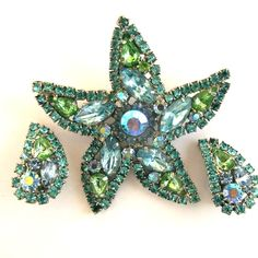 I have lots of starfish, but this is my favorite - Weiss Pale Blue and Green Rhinestone Starfish Brooch and Earring Set
