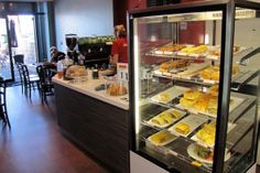 Sol Cafe - foodservice counter. Cafe servery counter and back bar display incorporating coffee, a chilled display cabinet, point of sale.