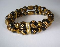 2  Gold and Bronze beads + crystal spacer