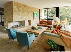 Love the cozy space and mix of colors and finishes. I would probably do ledger panels of sandstone to clad the fireplace, but otherwise, think this design is fabulous. Photo credit: Joe Fletcher and Marmol Radziner