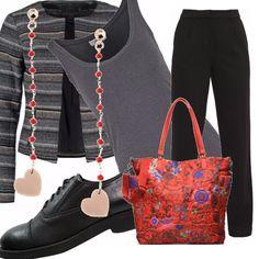 Colori e taglio rigorosi per l'outfit in grigio, composto da una canotta da abbinare ad un paio di pantaloni neri e aun cardigan corto a righe melange, scarpa di taglio maschile . Tocco di colore nella borsa, rosso con motivi floreali