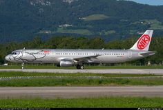 Niki Airbus A321-211 OE-LES aircraft with the nose like a bee, skating at Austria Salzburg W.A.Mozart International Airport. 06/06/2014.