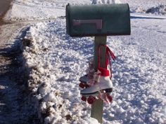 Christmas Roller Skates hanging on the mailbox at the littlestonehouse
