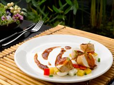 Tangerine's Chicken Roulade features free-range chicken with bell pepper, lily bulb, white onion and a mandarin orange sauce. Enjoy the dish at ESPA at Resorts World Sentosa. Find out what inspires Chef Ian Kittichai, consulting chef at Tangerine.