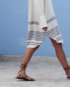 The length of this shirt dress is perfect for more traditional cultures you may be exploring. The sandals are a neutral color that can go with anything and you can stay comfortable while exploring.