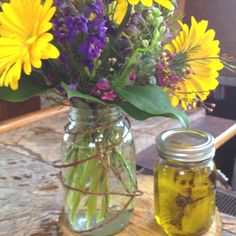 Erin's shower centerpiece. Olive Oil Mason Jar with picture and wild flowers in mason jar.