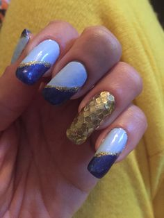 Royal and powder blue manicure with gold glitter and sequins