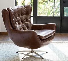A swivel chair couldn't get more inviting than this. Plush and roomy, our Wells Leather Tufted Armchair is wrapped in top-grain leather for sink-in comfort. Rich leather creates a beautiful counterpoint to the exposed metal base. Upholstered Arm Chair, Furniture Upholstery, Chair And Ottoman, Chair Cushions, Comfy Armchair, Swivel Armchair, Wayfair Living Room Chairs, Office Chair Without Wheels, Occasional Chairs